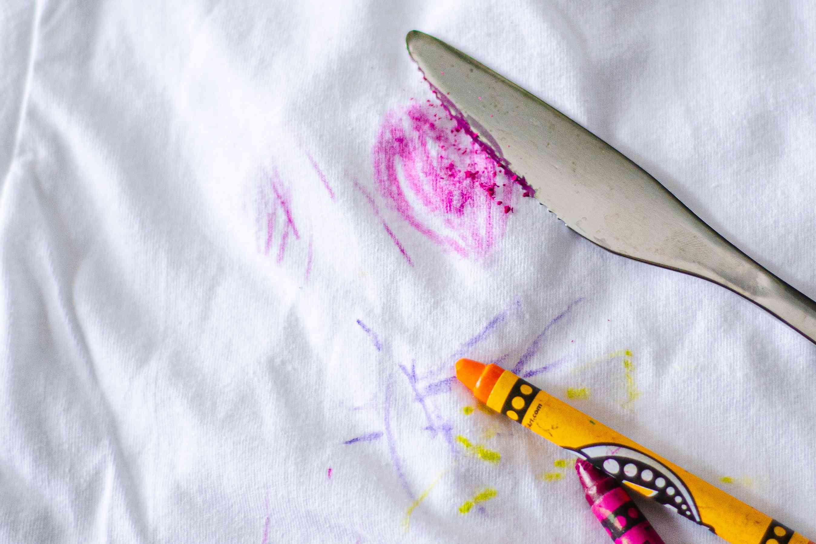 scraping away crayon solids