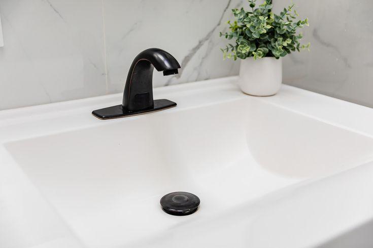 Pop Up Drain Stopper In A Bathroom Sink, Bathroom Sink Pop Up Stopper Assembly