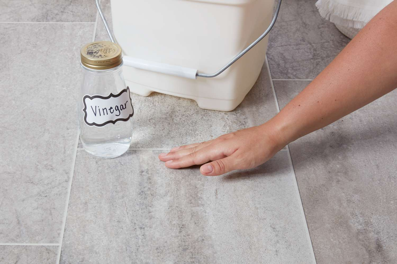 Clean vinyl floor with vinegar and water solution