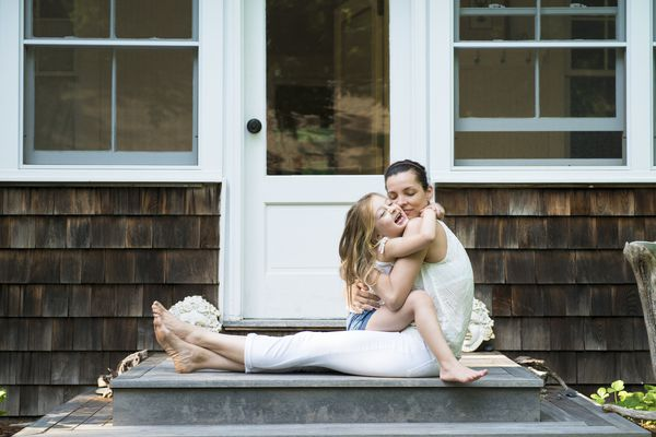 Mother hugging her daughter - stock photo