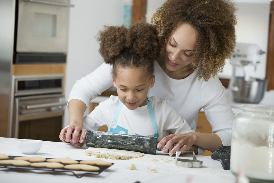 A picture of a mom and daughter baking
