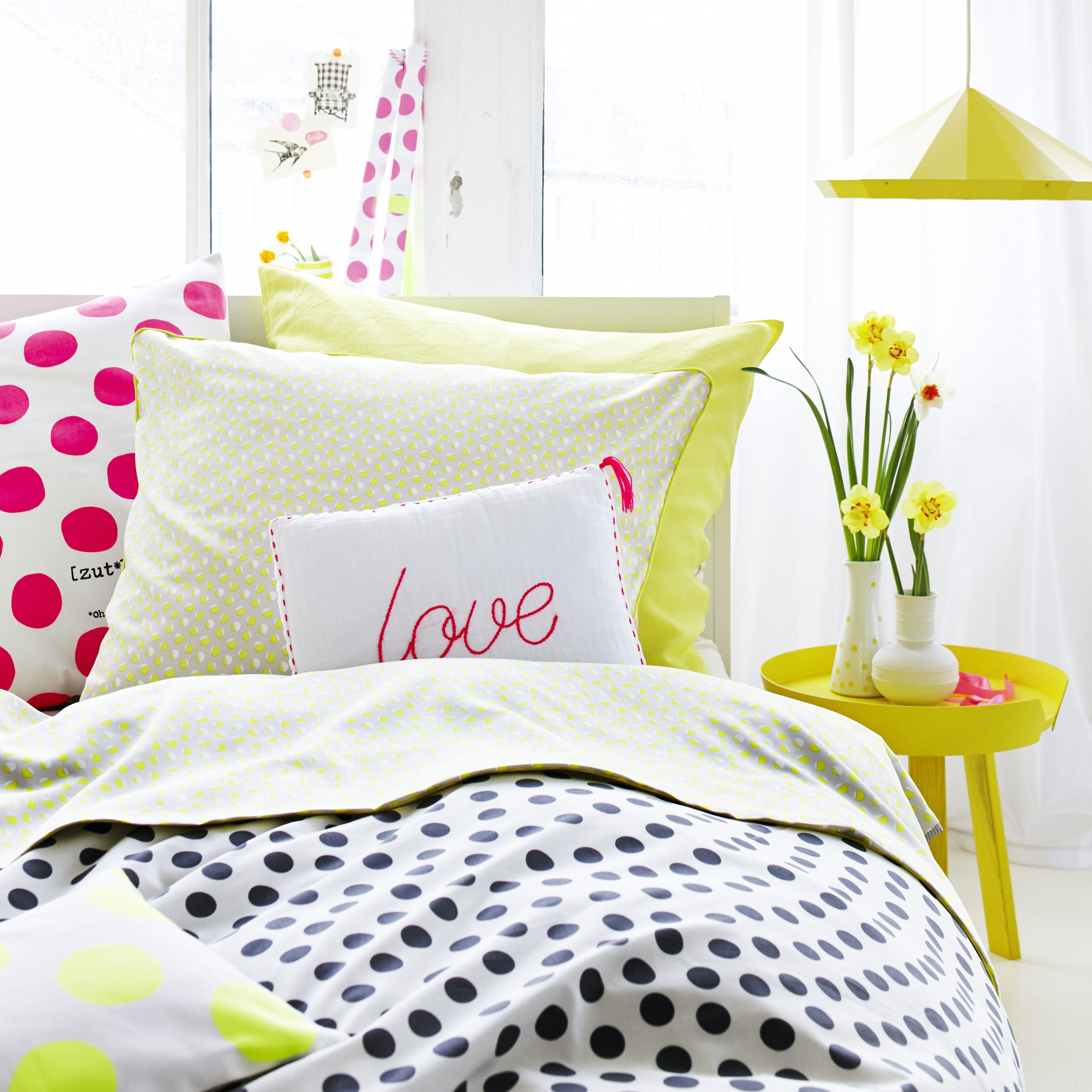 Cute bedroom with throw pillows