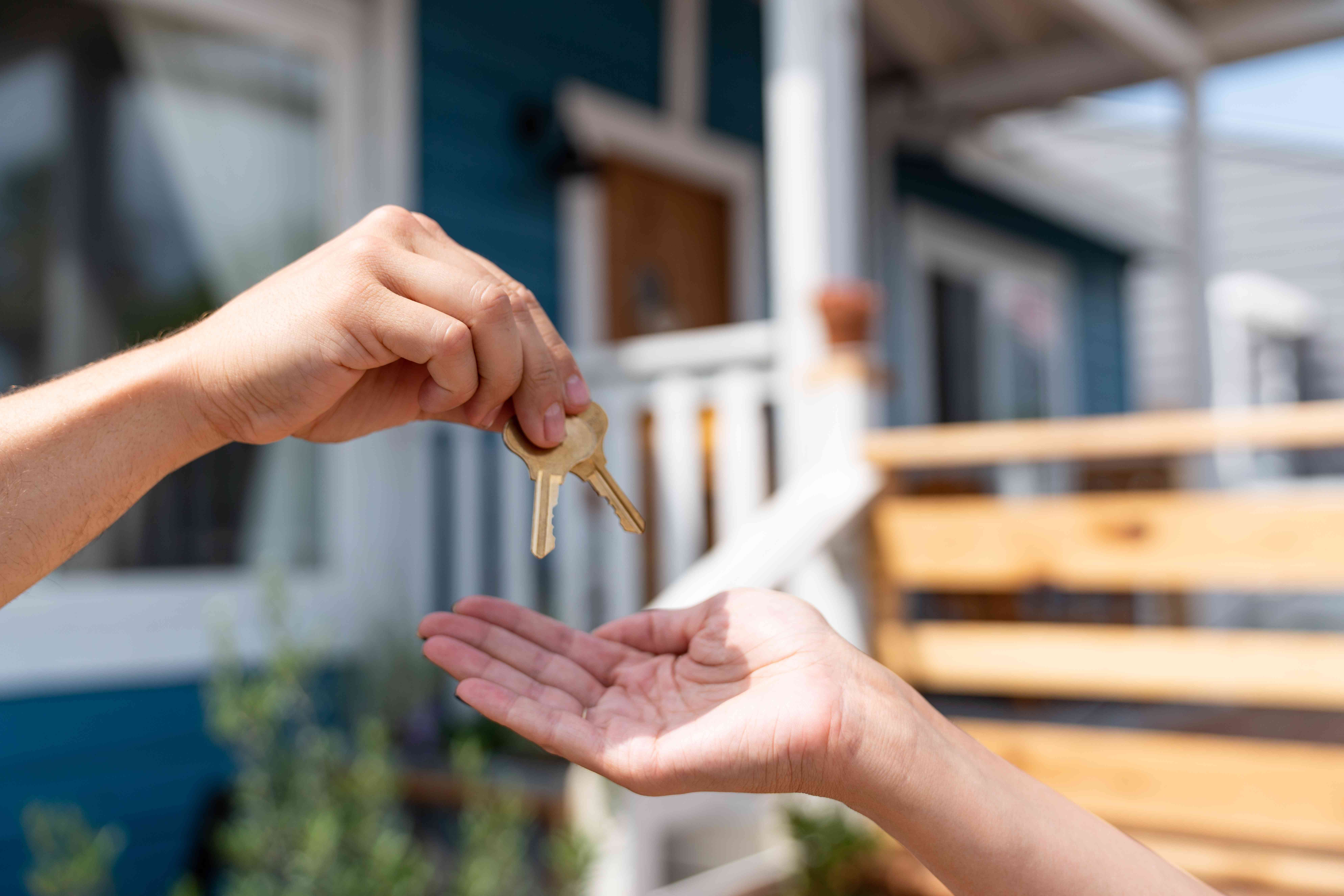 Keys being handed over after buying a home