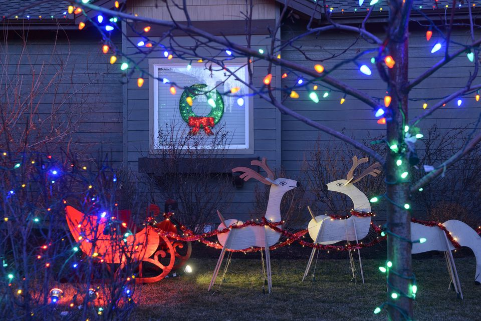 25 outdoor christmas decoration ideas in pictures cutout christmas display with reindeer pulling a sleigh plus lights aloadofball Image collections