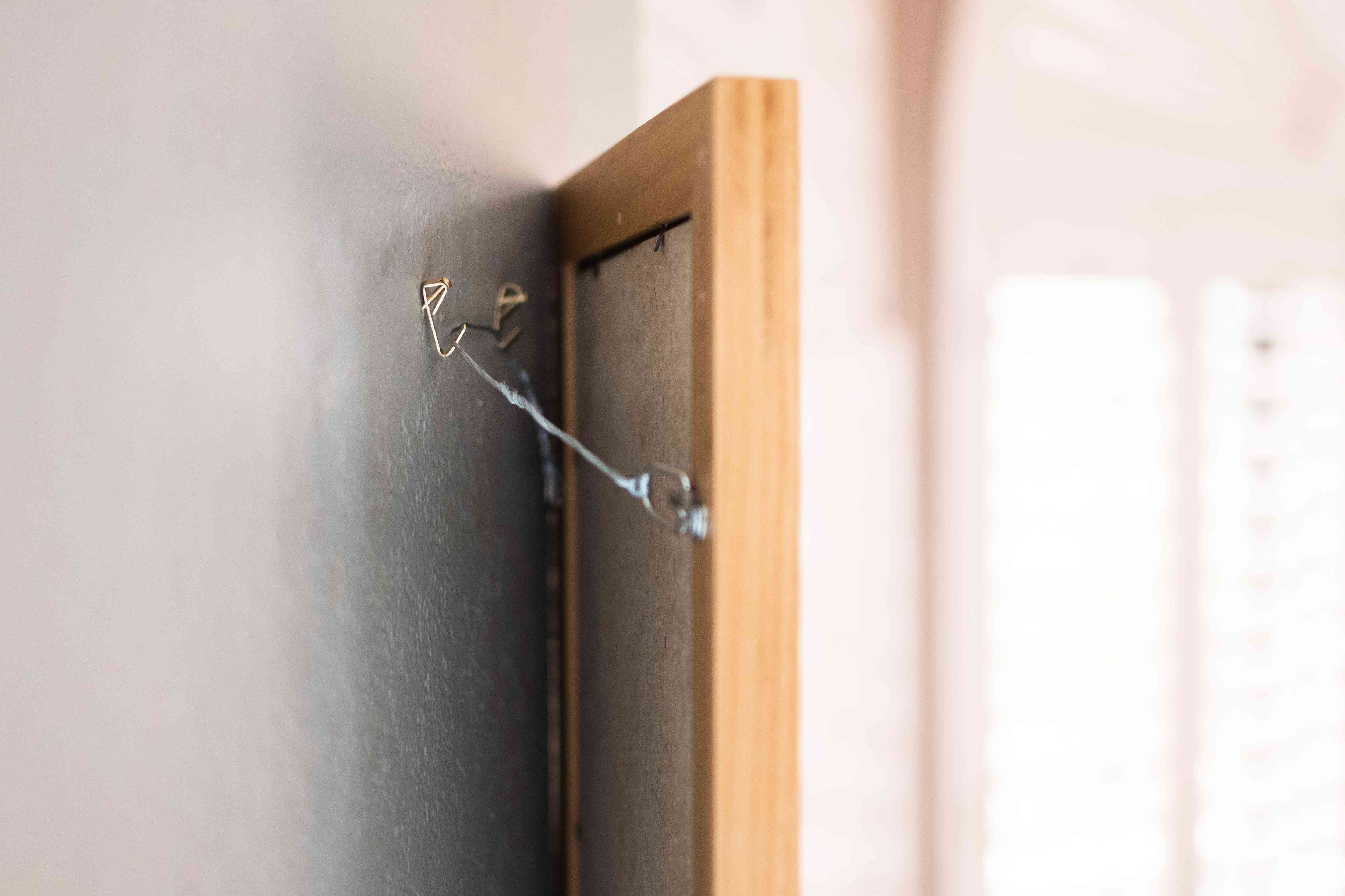 Picture frame with wire on wall hangers