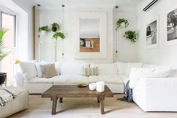 A white sofa in a beachy casual living room