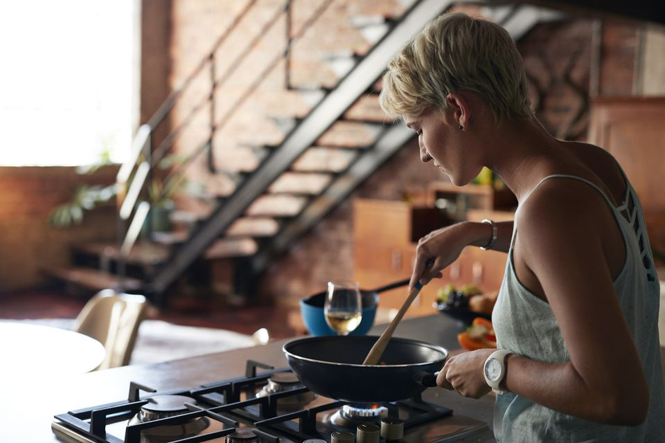 woman cooking on cooktop