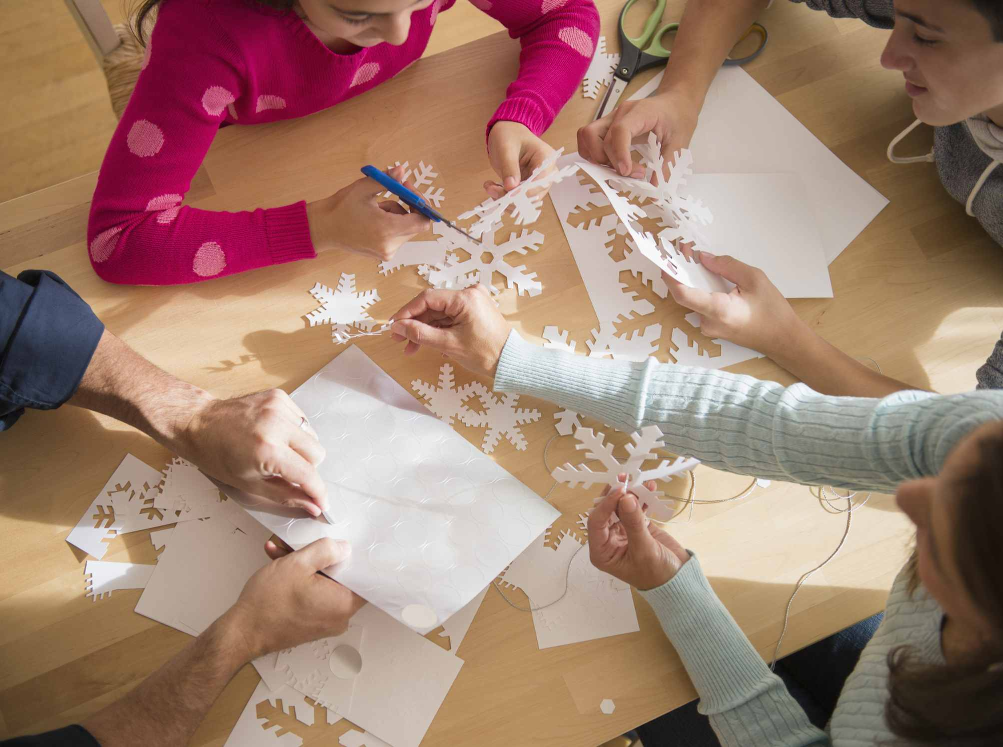 Family making paper snowflakes