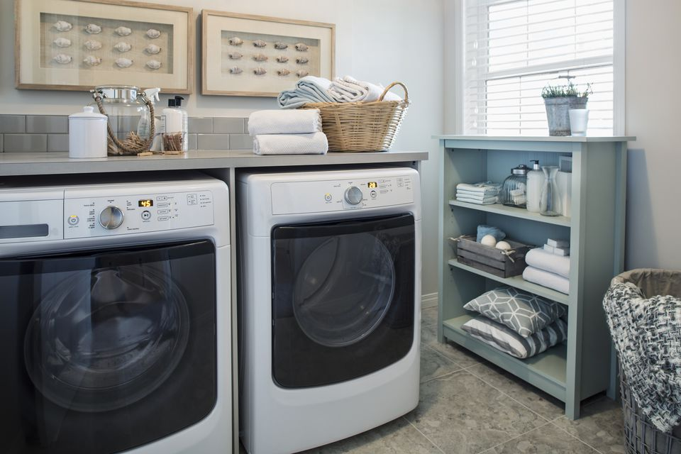 Blue and white coastal themed laundry room