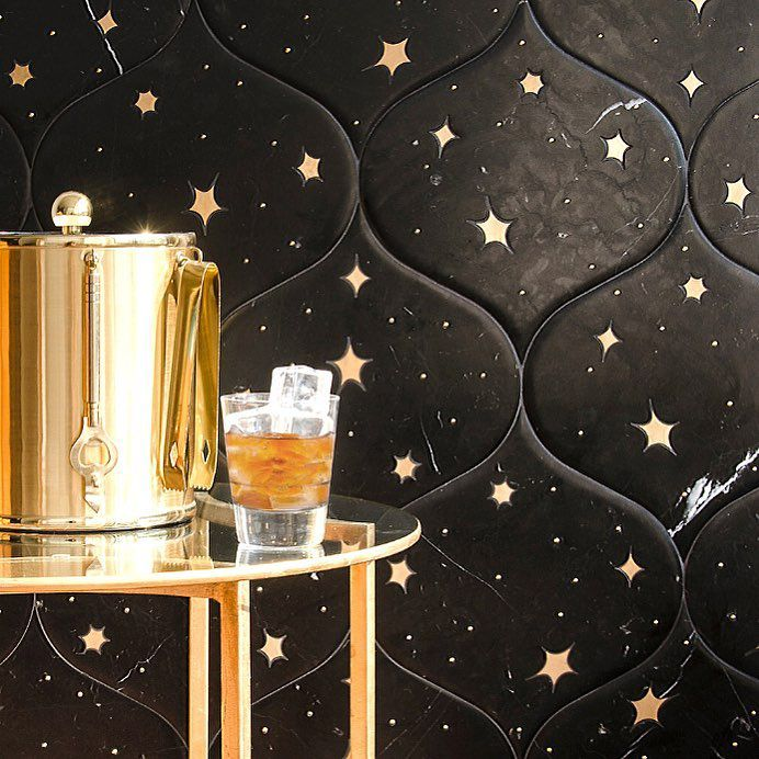 Bar cart in front of star tile wall