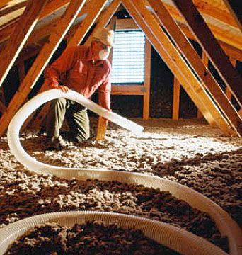 Spraying blown-in insulation.