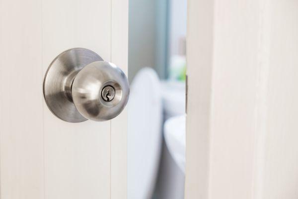 Close-up door stainless door knob, with door open slightly