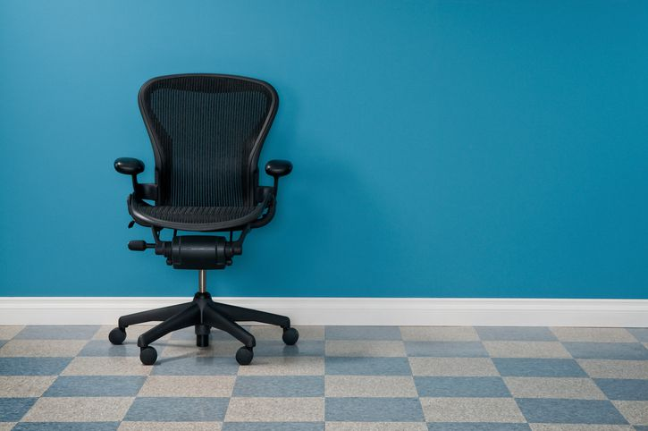 Office chair against a blue wall