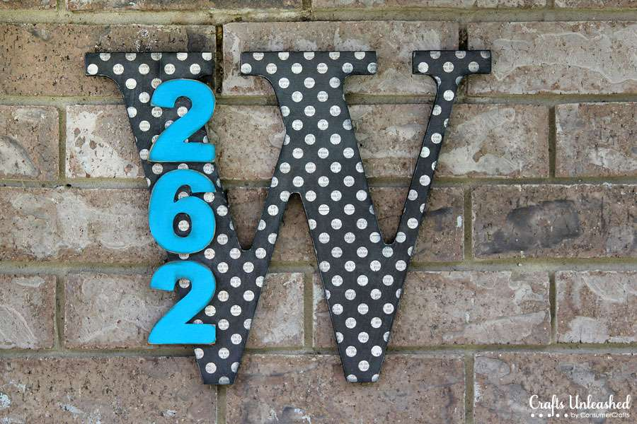 Wooden monogrammed house numbers.