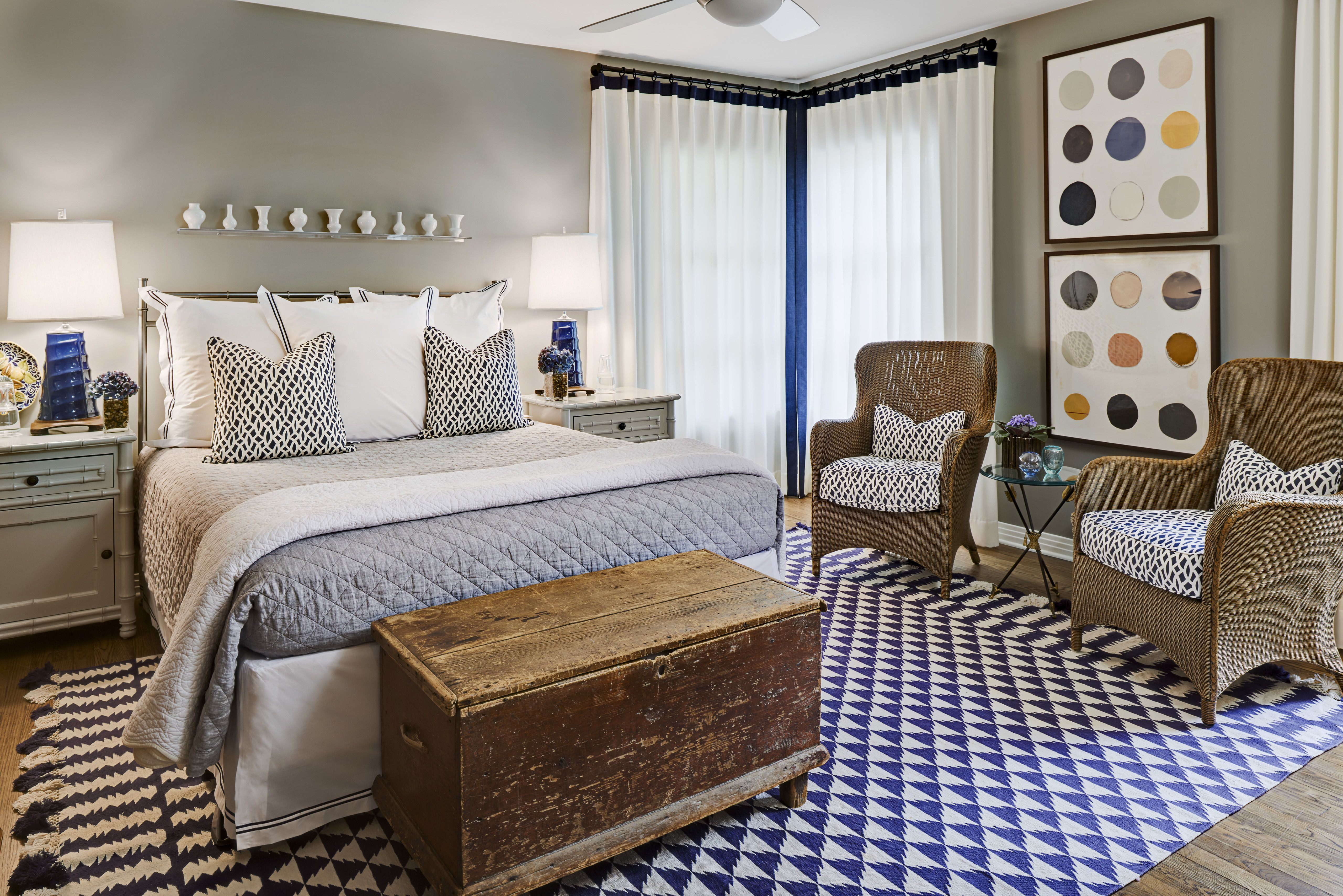 Bedroom with blue and white area rug.