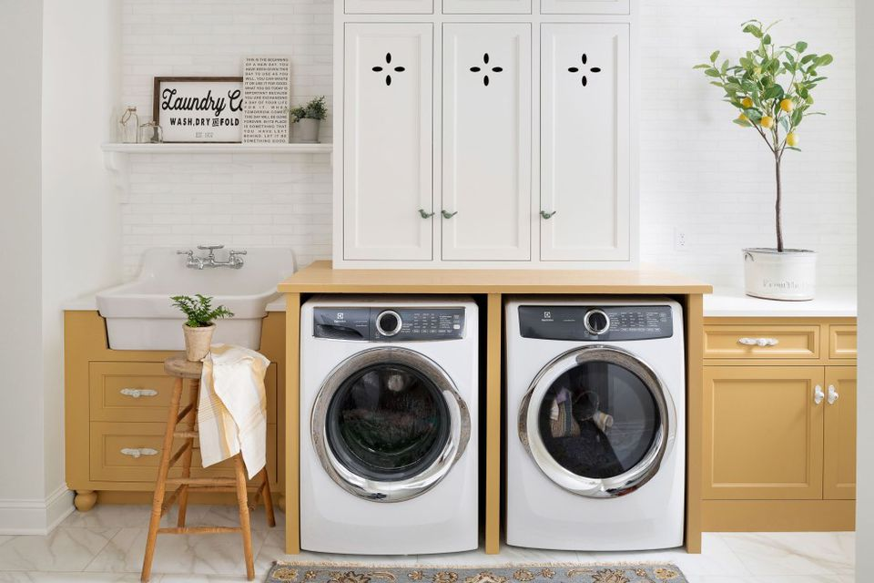 Lovely retro inspired yellow laundry room