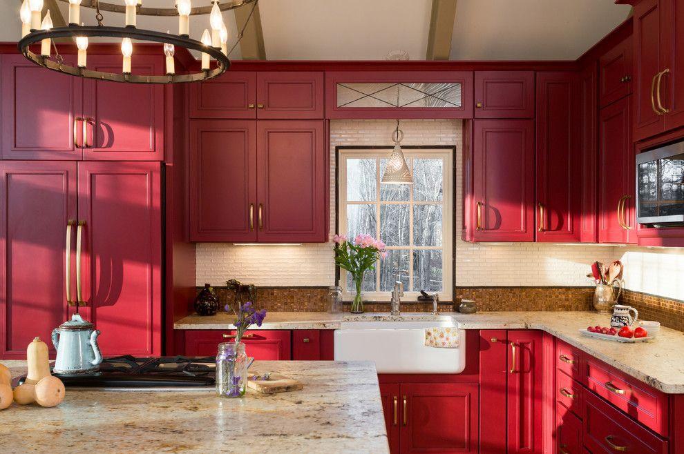 Red farmhouse kitchen with granite countertops