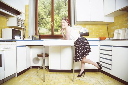 portrait of young woman in vintage clothes in vintage kitchen 5b1af2dd8023b e