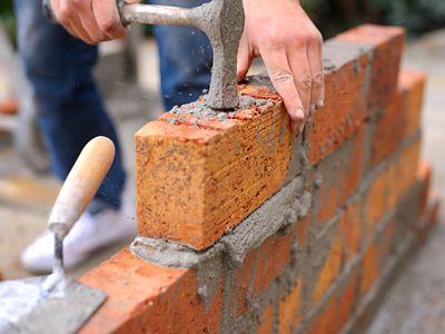 Laying brick foundation