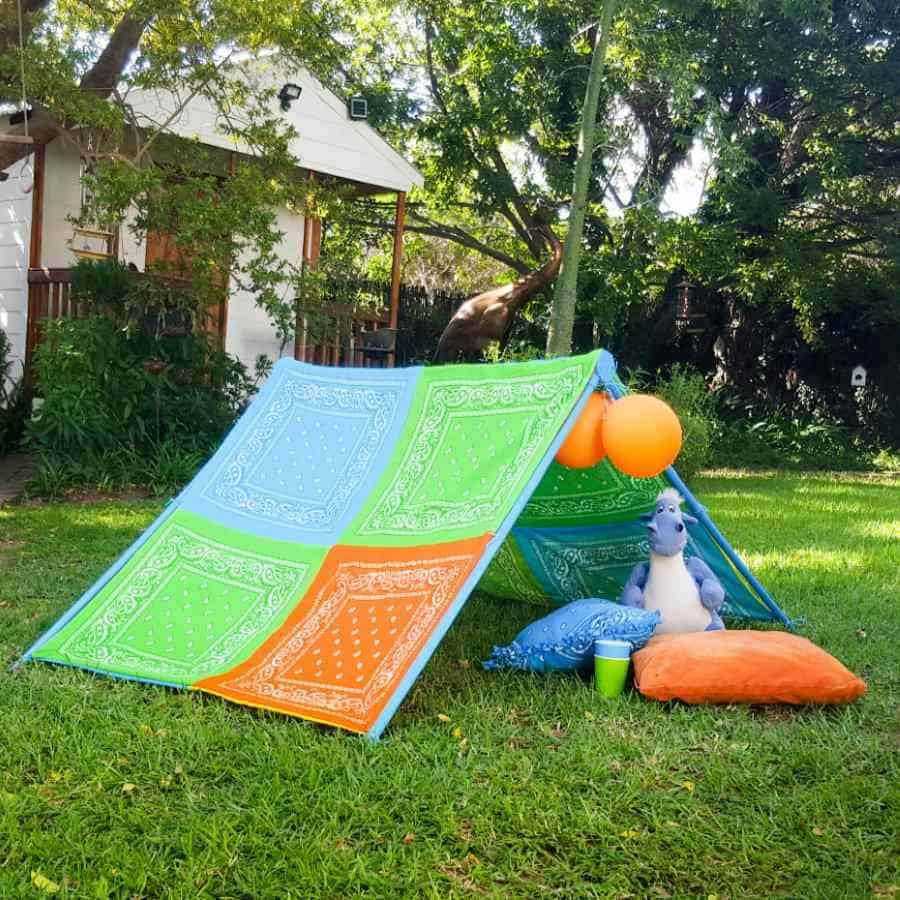 A colorful play tent in a yard