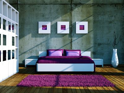 Modern bedroom with purple bedding and rug.