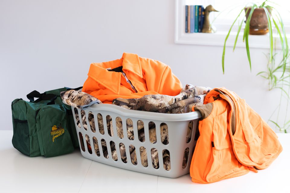 Laundry basket with hunting clothes and duffle bag
