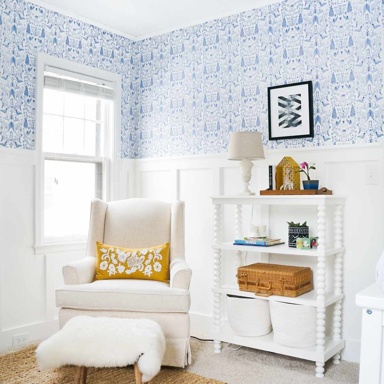 Blue and white nursery with wallpaper print and wood paneling