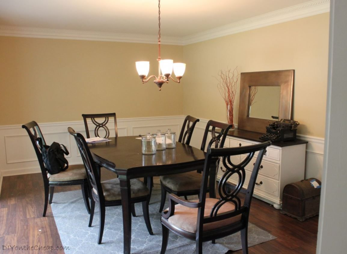 Traditional dining room with dark wood table and chairs.