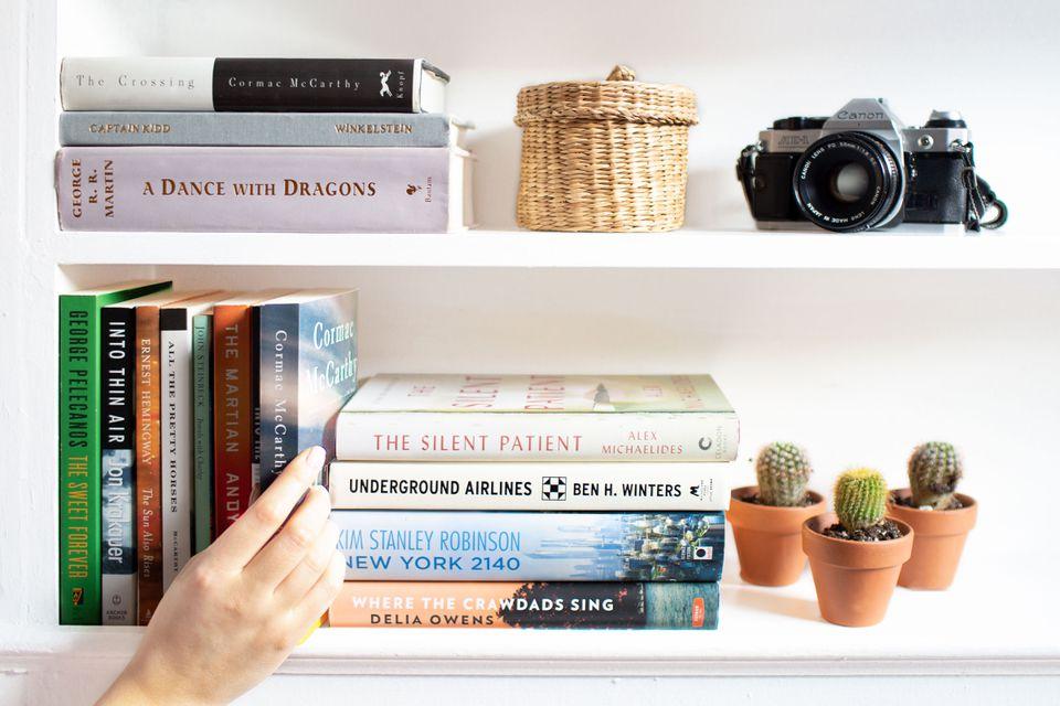 placing books onto a shelf