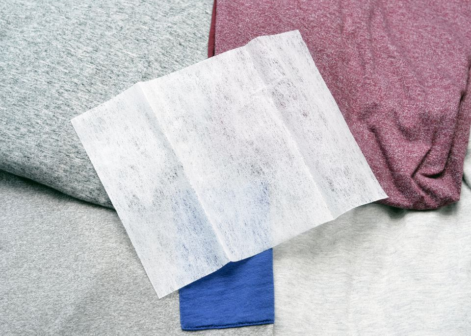 Fabric softener sheet on folded laundry