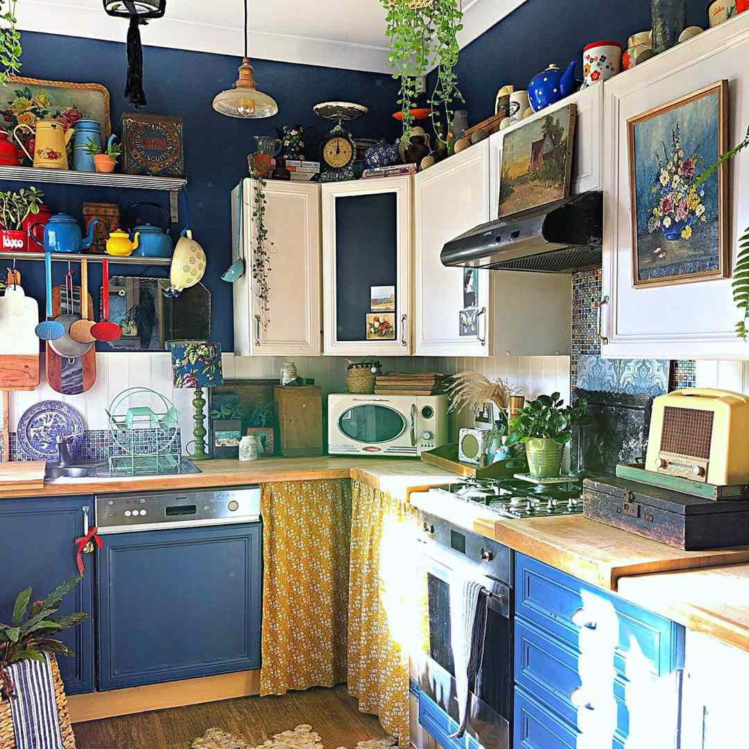 Blue kitchen with plants everywhere