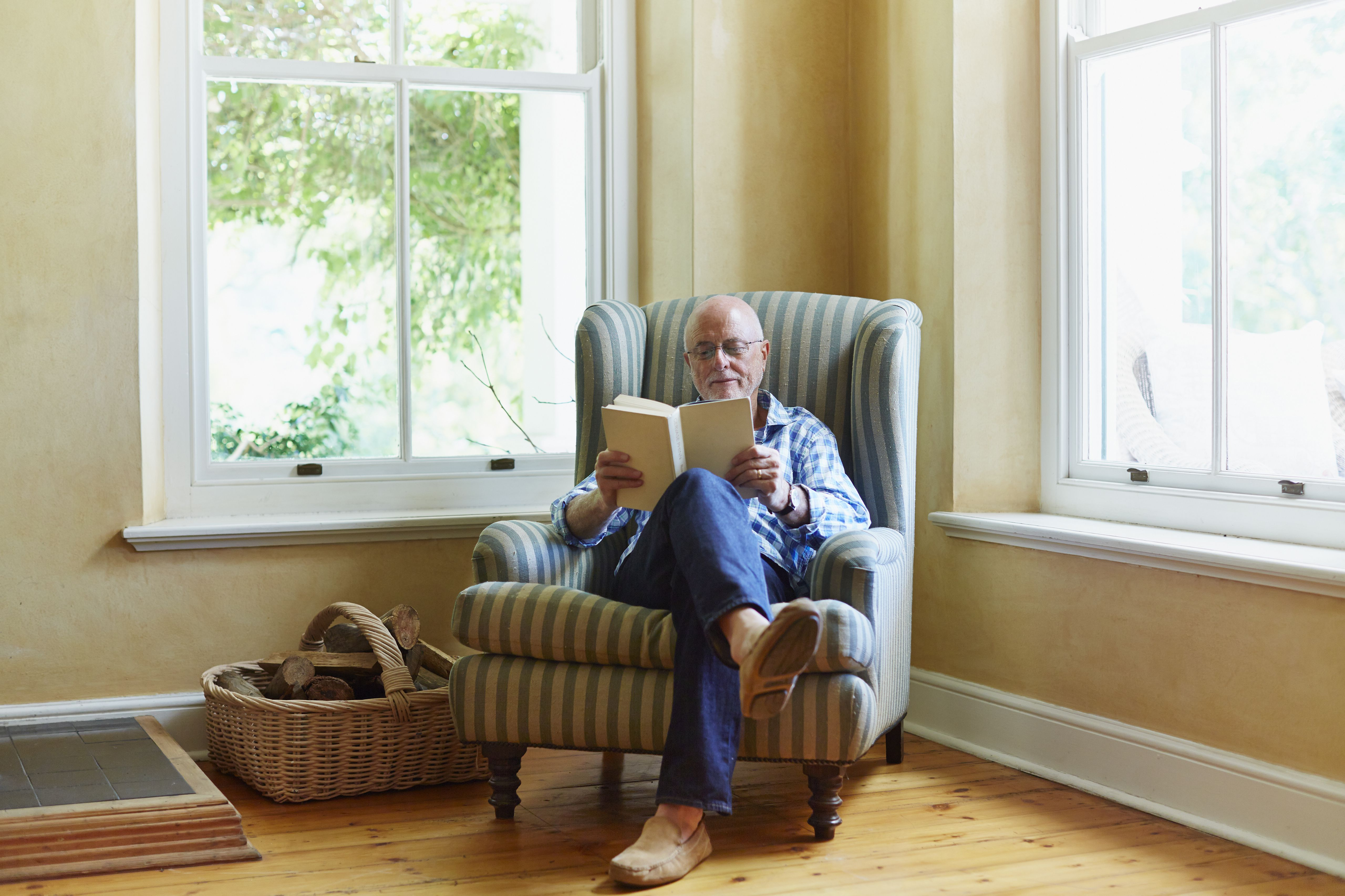 senior man reading book at home 6c8f8395d2d74dddaed c6e77f5