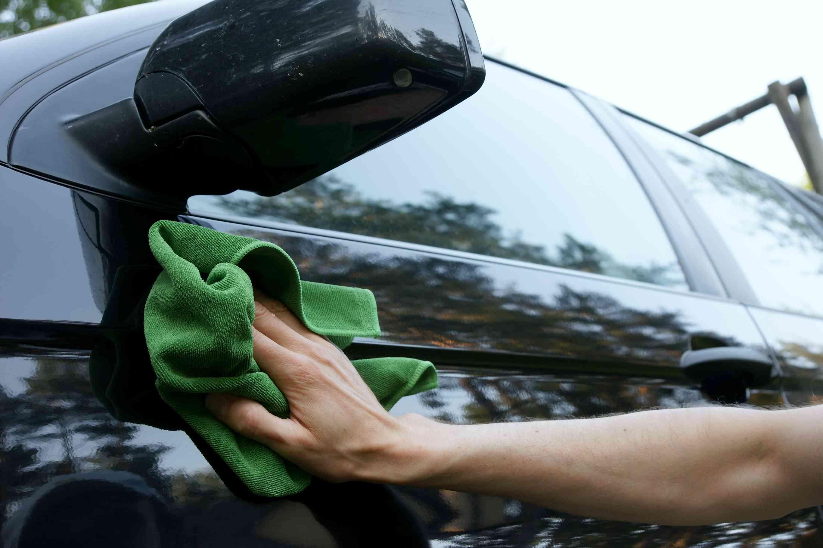 Washing car using a green cloth rag