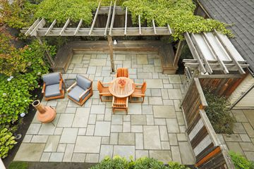 Aerial view of patio with furniture and pavers.