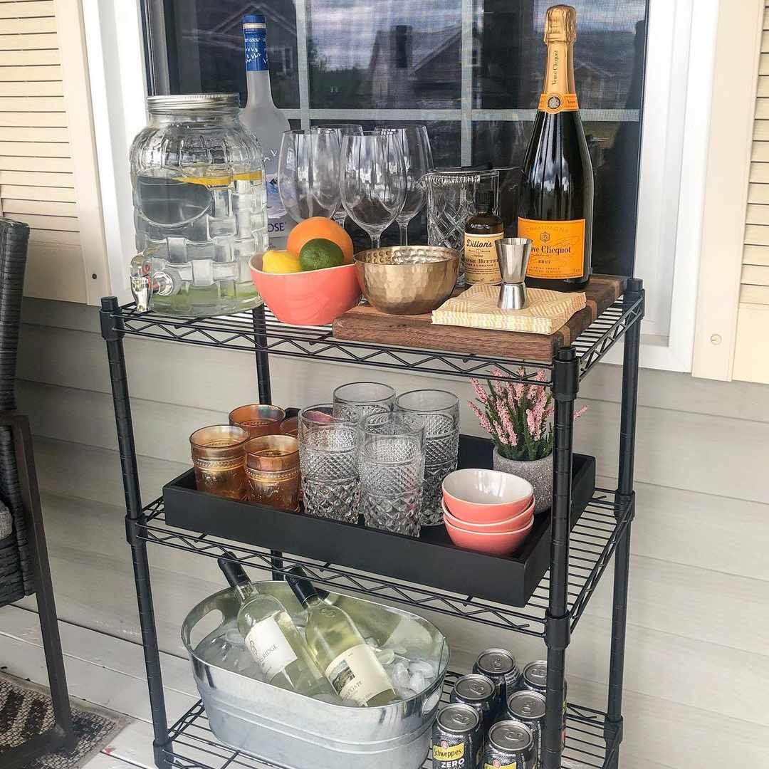 A DIY outdoor bar cart made from wire shelving.