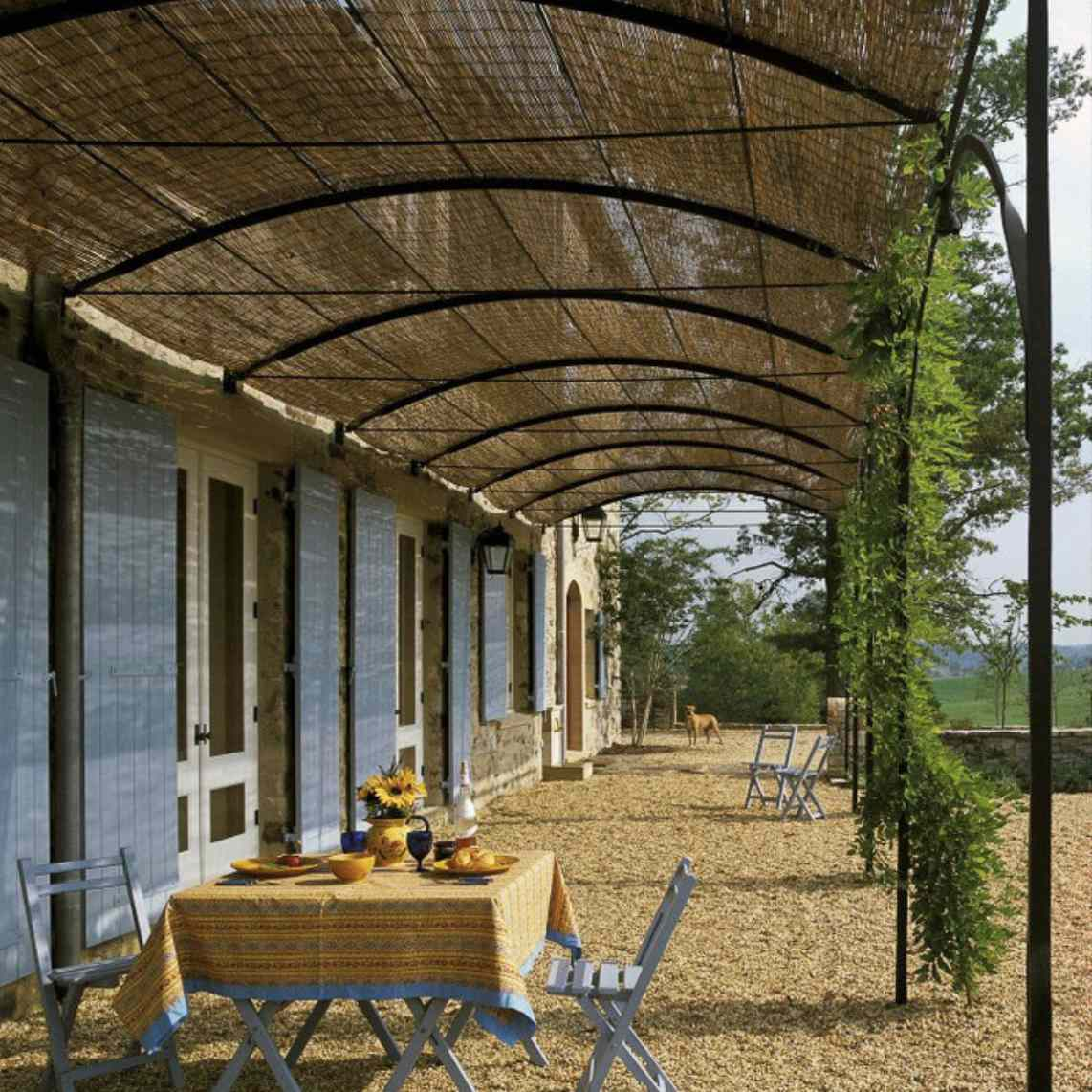 covered patio straw roof on wood chips