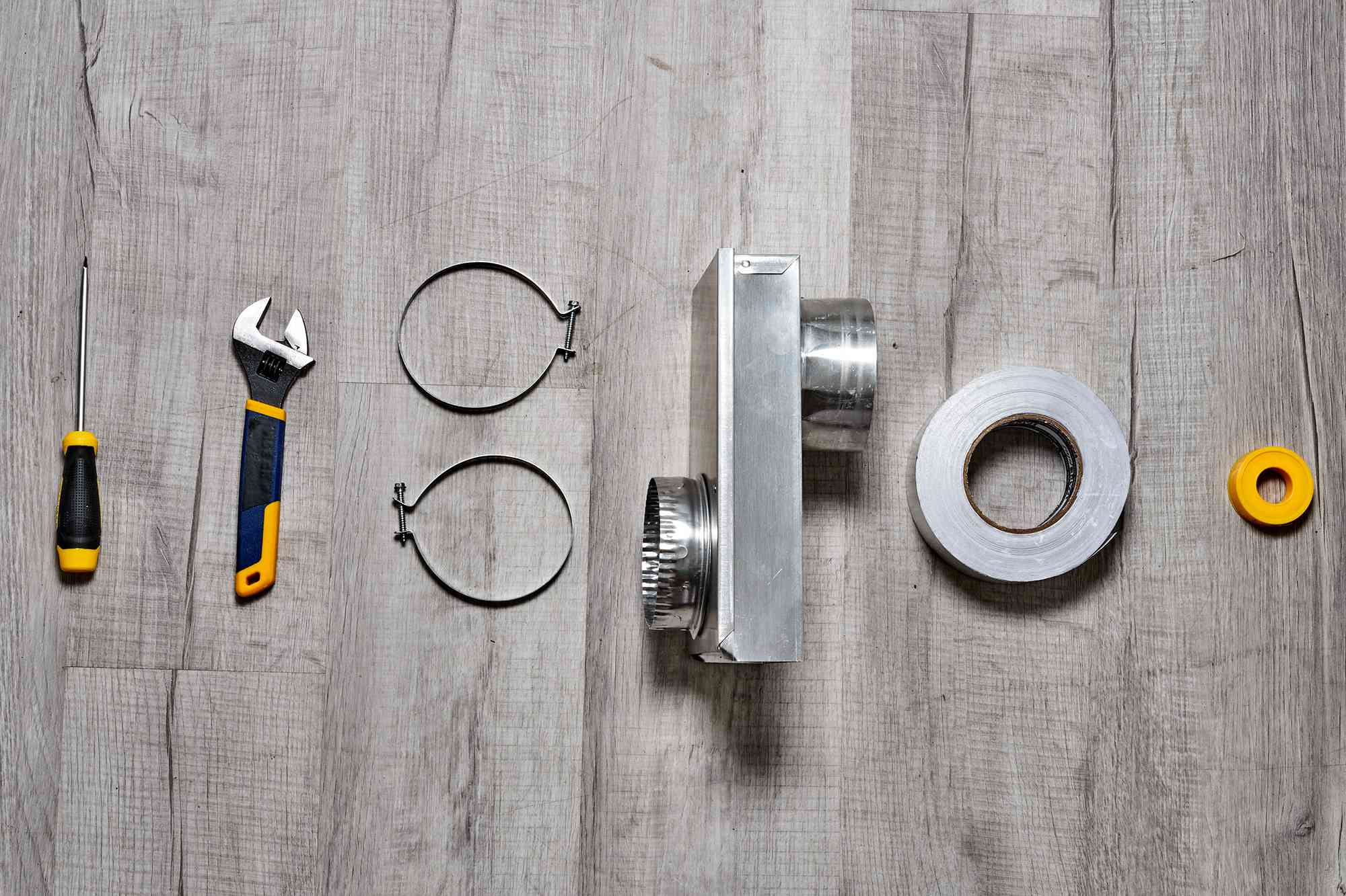 Materials and tools to install a dryer vent in a tight space