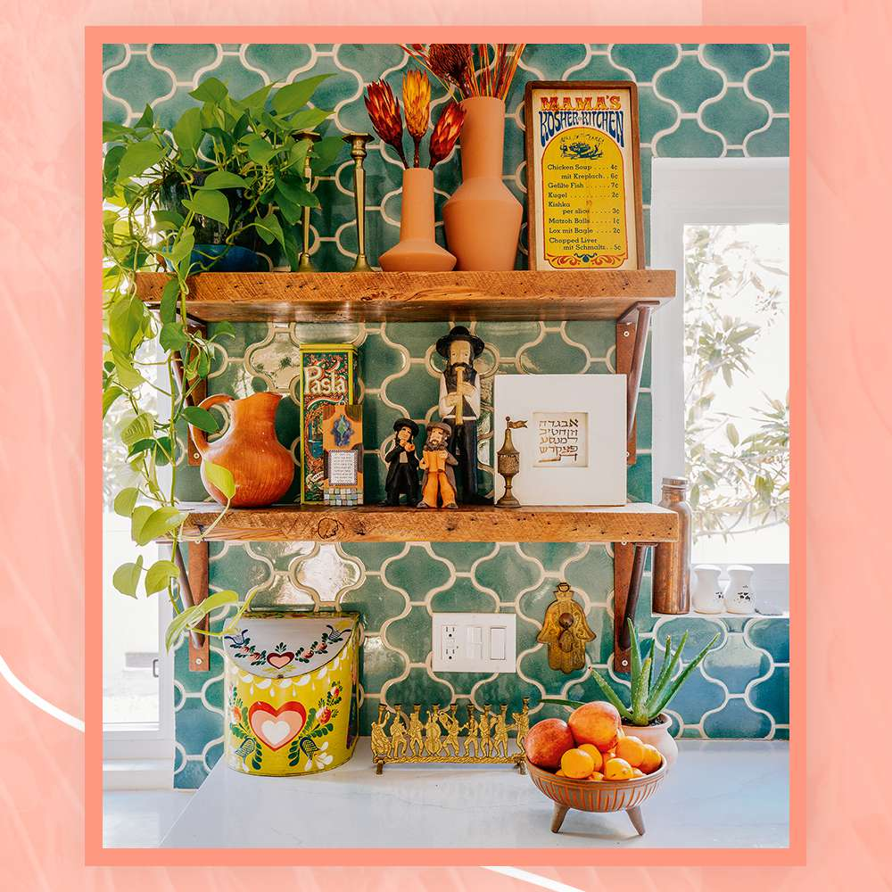 open shelving in kitchen with plants, figurines, and vases