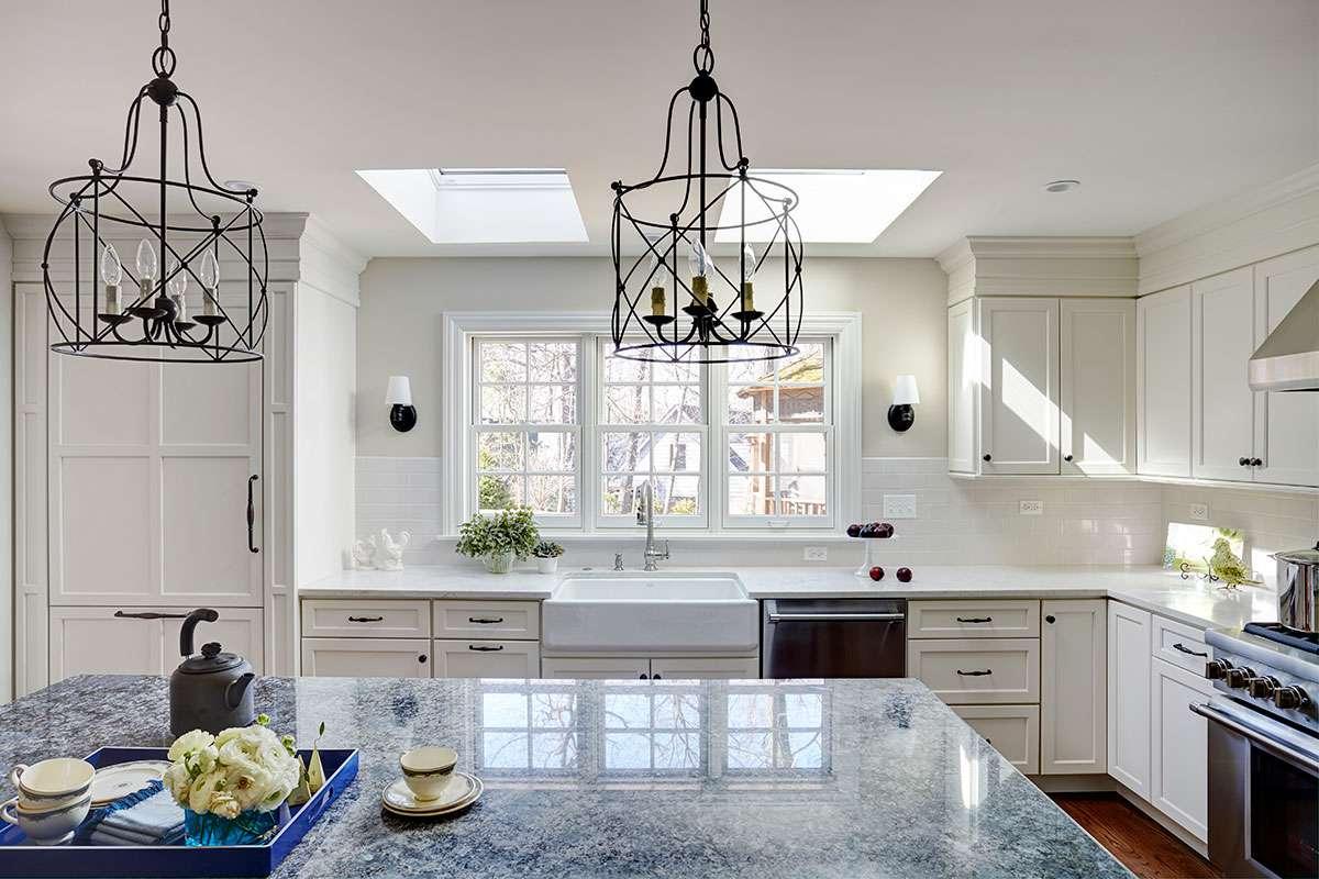 gray corian countertop in shaker style kitchen