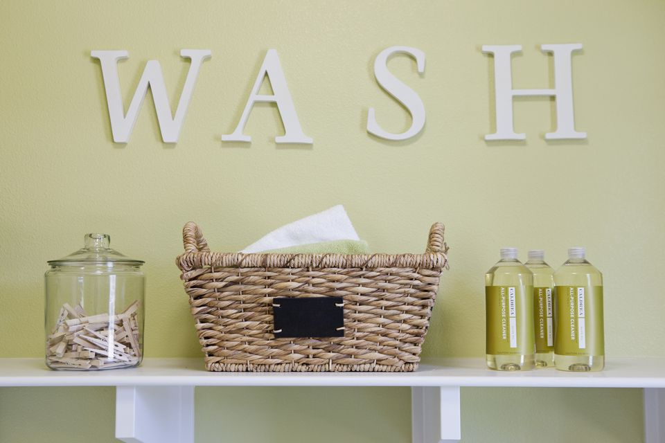 "The words ""Wash"" against a wall with bathroom supplies"