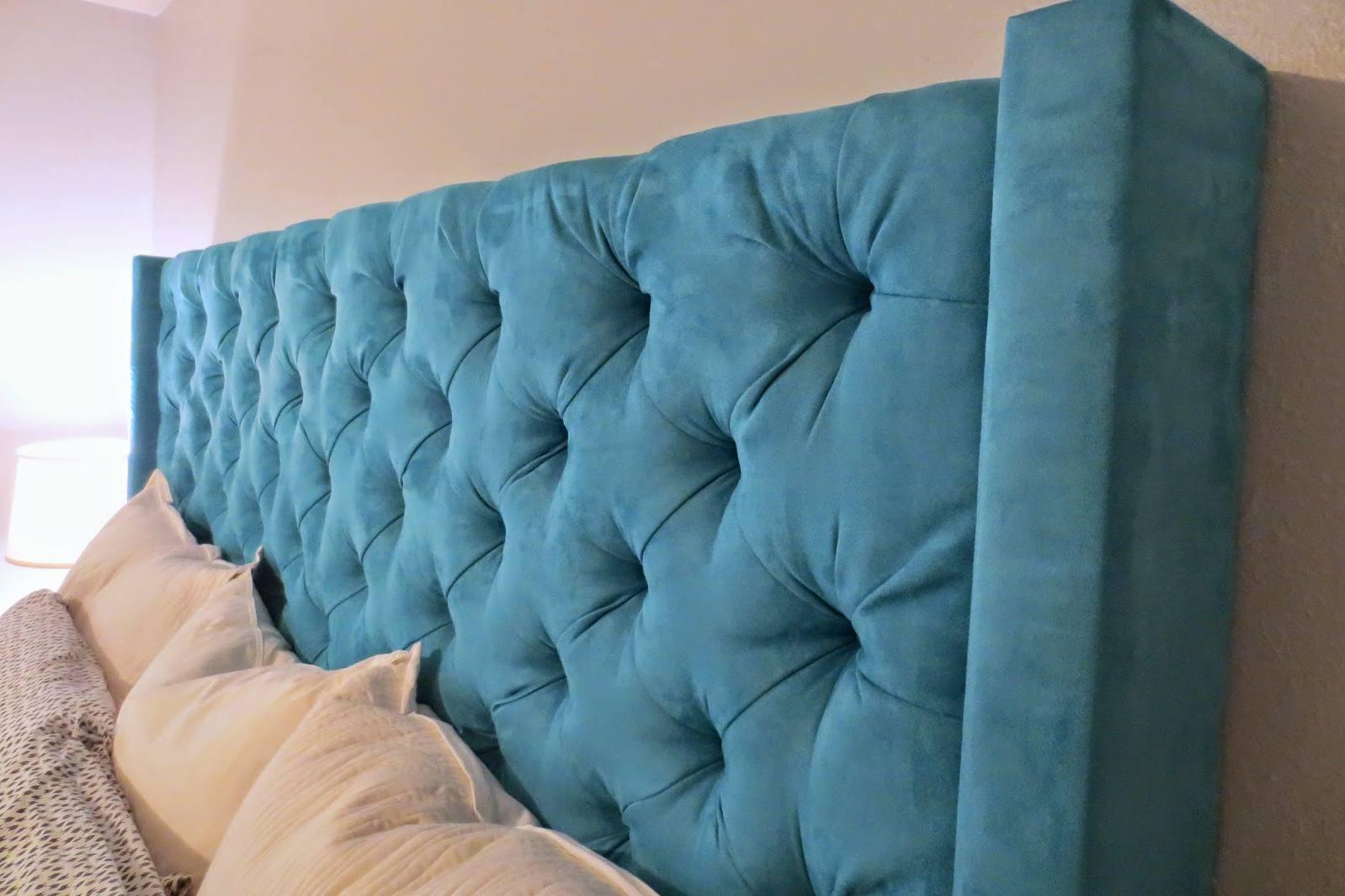 blue tuffted peg board headboard