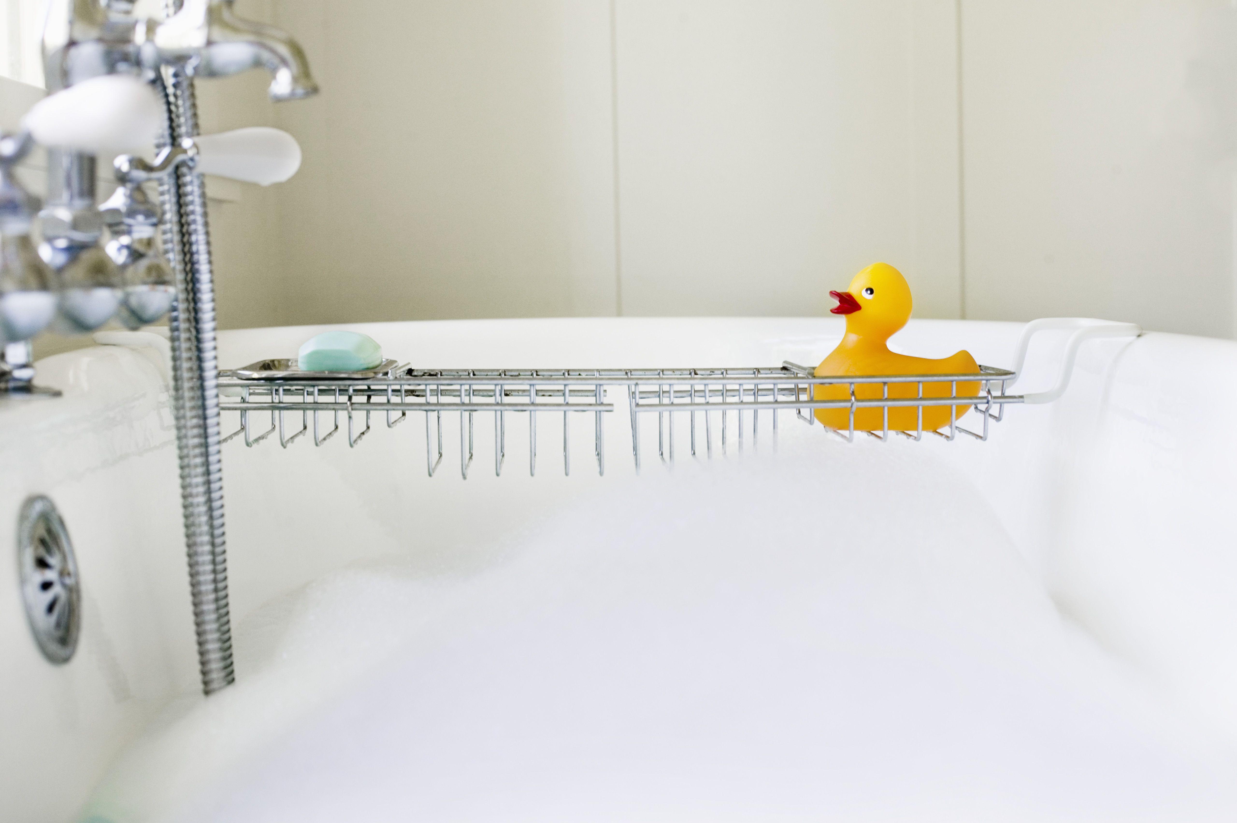 Rubber duck on rack over bathtub