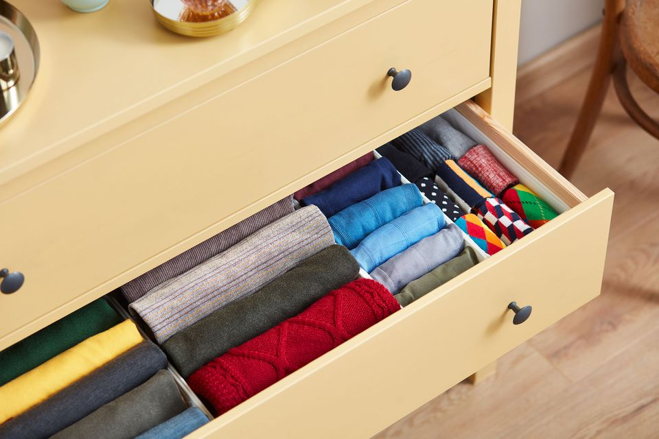 Clothing folded neatly in a drawer following the KonMari method