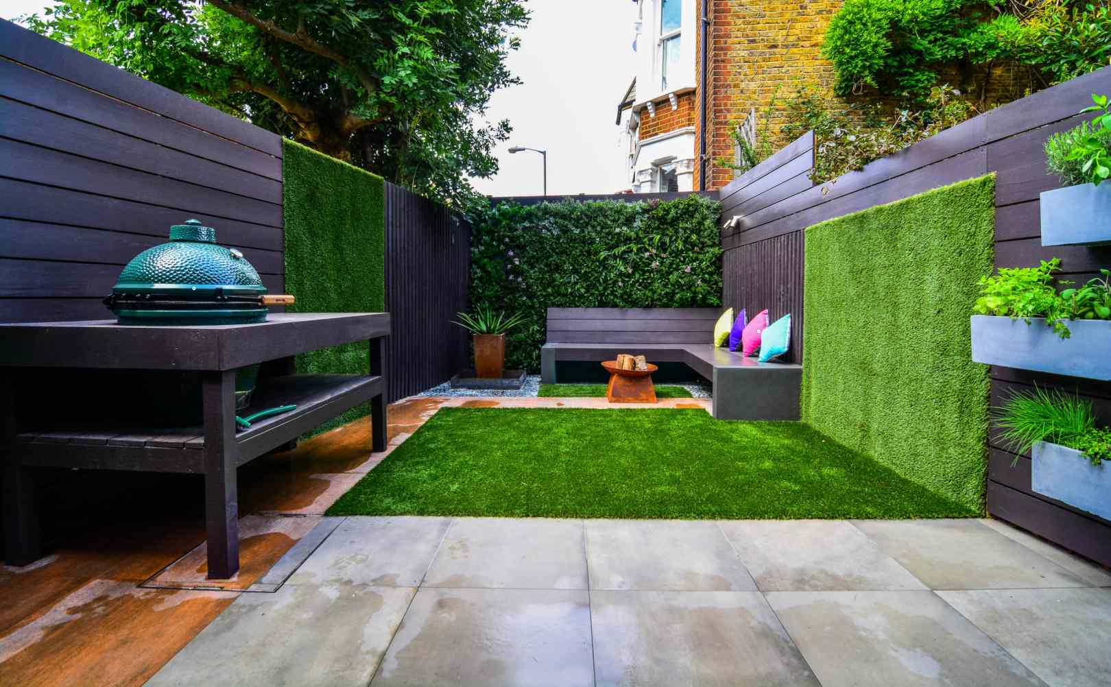 Backyard with grass growing as walls.