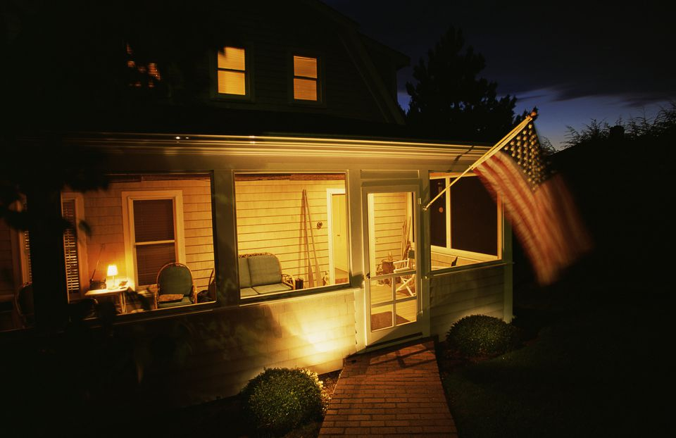 Porch with American flag at night