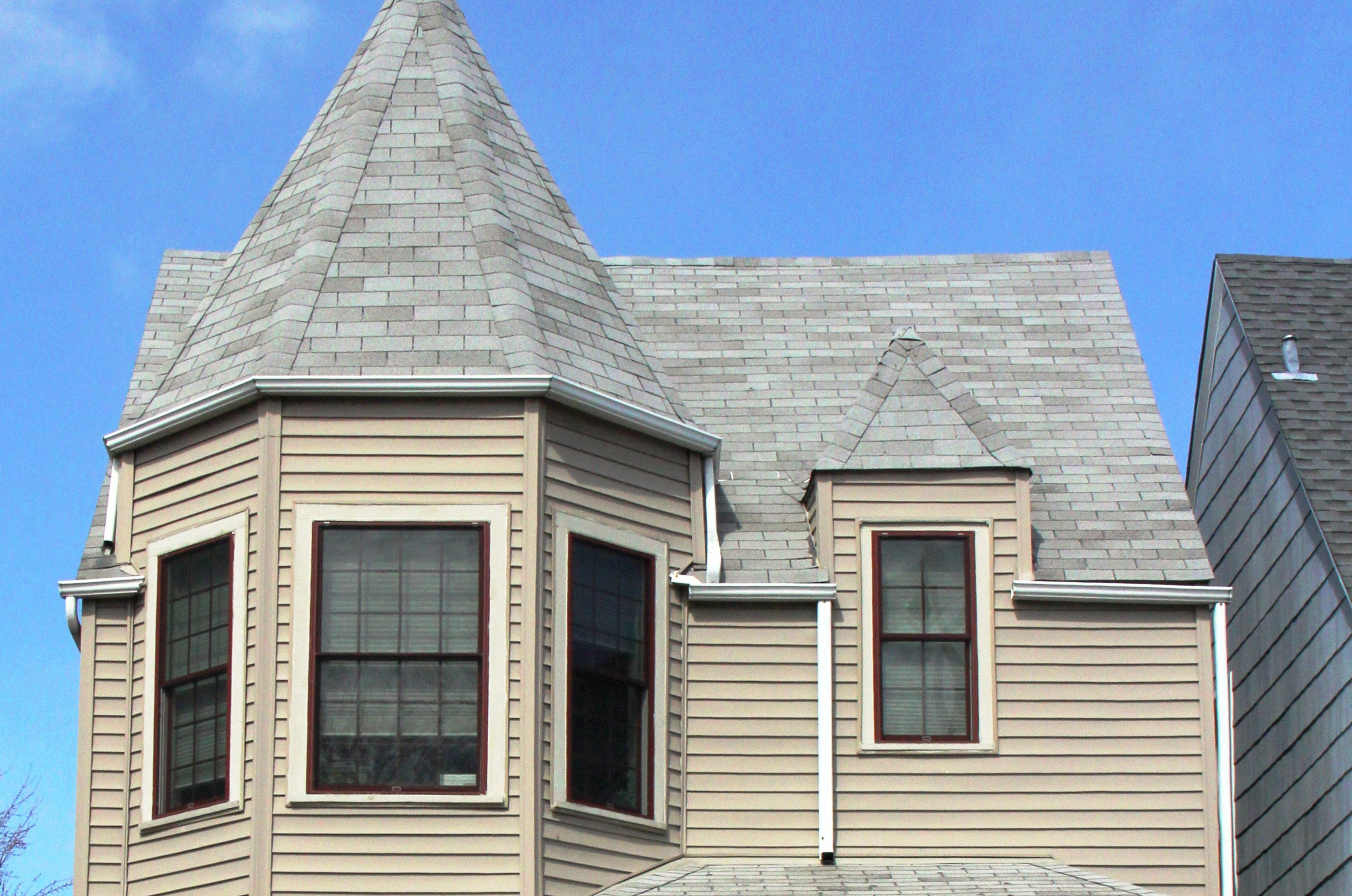 Synthetic Siding on a Queen Anne Victorian Hides Architectural Details