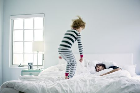 Jumping On Sleeping Father In Bed