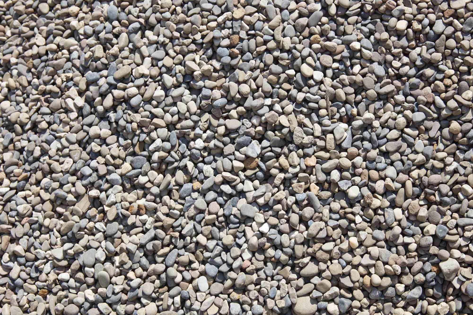 Loose materials of pea gravel in sunlight
