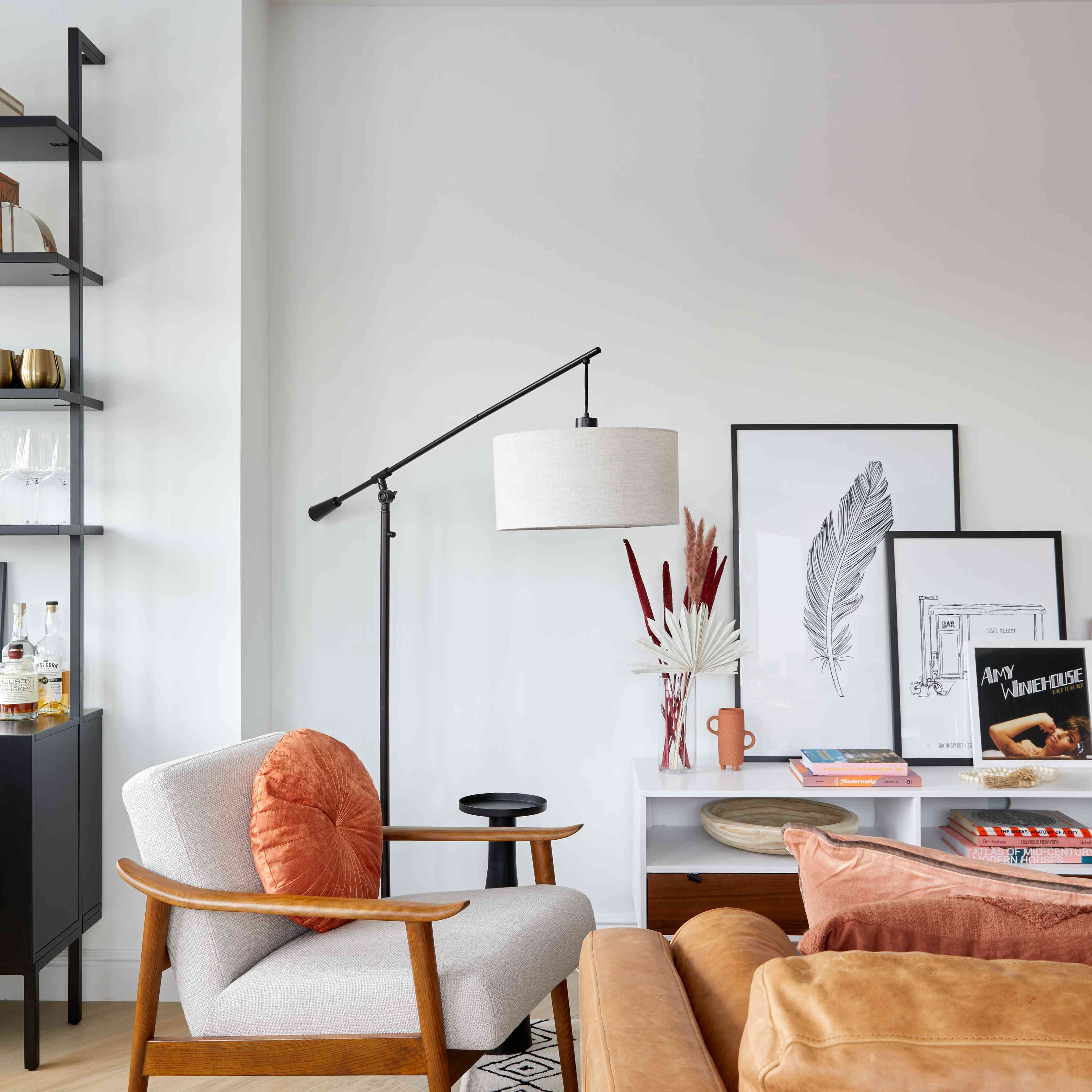 a living room with neutrals and black and white pieces