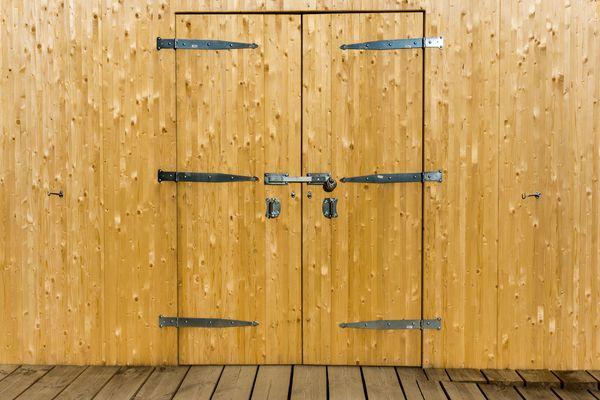 Door hinges on a wooden door
